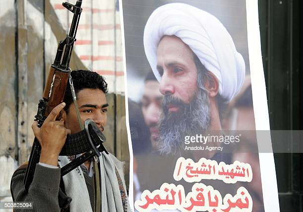 An armed Houthi holds a rifle during a protest against the execution of prominent Saudi Shia cleric Nimr Baqir alNimr by Saudi authorities in Sanaa...