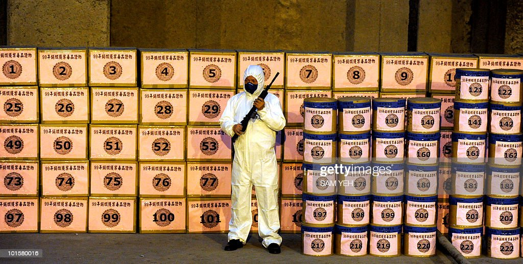 An armed Investigation Bureau staff guards confiscated drugs before being incinerated at a public incinerator plant in Taipei May 5, 2010. More then 1,400 kilograms of heroin, morphine and marijuana were seized by the Investigation Bureau in 2009. AFP PHOTO/Sam YEH