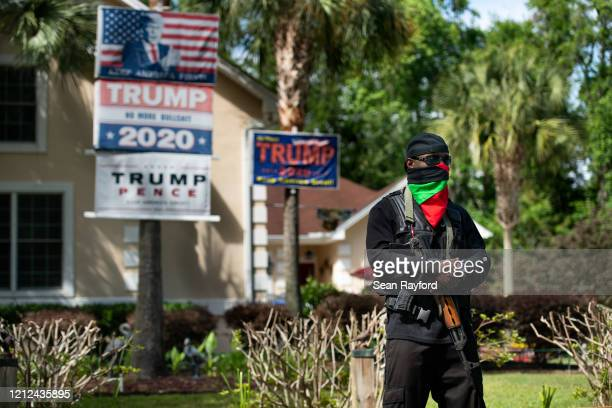 An armed man demonstrates in the Satilla Shores neighborhood on May 9, 2020 where Ahmaud Arbery was shot and killed in Brunswick, Georgia. Arbery, a...