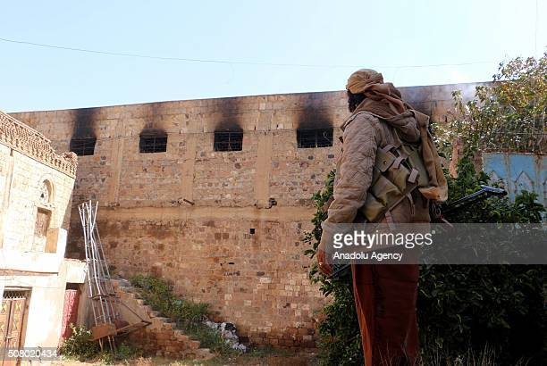 An armed man stands near the national museum, under the control of Popular Resistance Forces, after a Houthi shelling in Taiz, Yemen on February 2,...