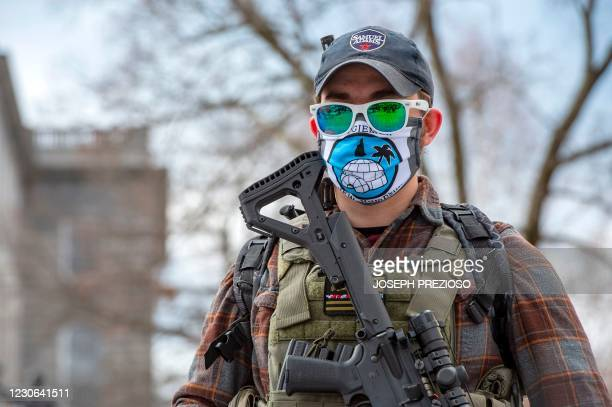An armed member of the Boogaloo militia stands in front of the State Capital in Concord, New Hampshire on January 17 during a nationwide protest...