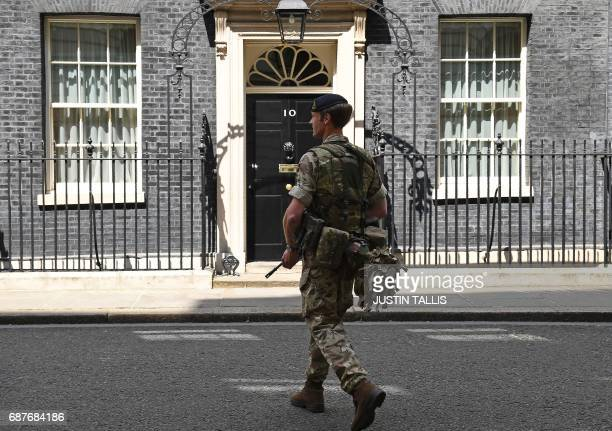 An armed member of the British Army carries his weapon as he patrols outside 10 Downing Street the official residence of Britain's Prime Minister in...