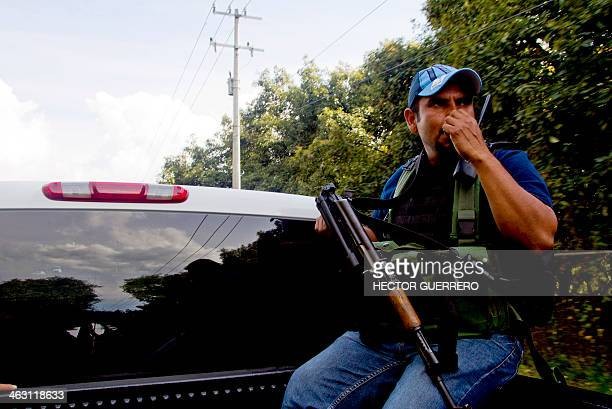 An armed member of the citizens' selfprotection police patrol in Tancitaro community state of Michoacan Mexico on January 16 2014 The land is one of...