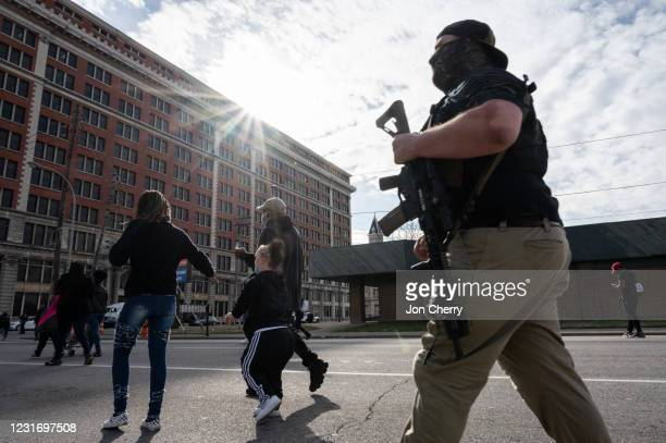 An armed member of the militia known as the Boogaloo Bois marches with protesters during a Breonna Taylor memorial march near Jefferson Square Park...