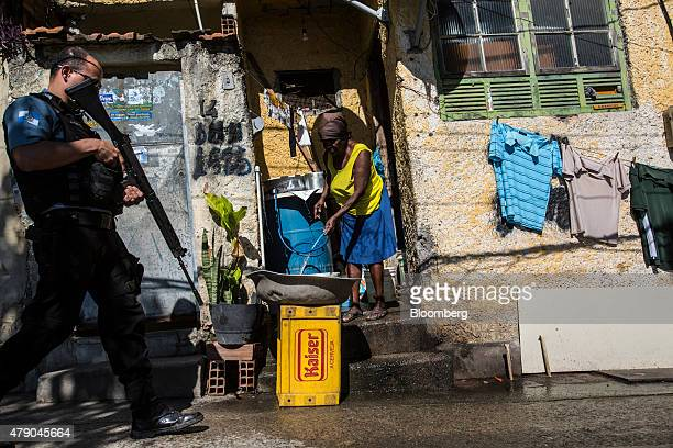 An armed officer from the Pacifying Police Unit patrols in the Providencia favela of Rio de Janeiro Brazil on Tuesday June 23 2015 Brazil expects...