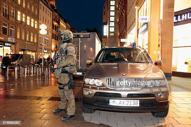An armed police man guards the downtown pedestrian zone near Marienplatz square following a rampage shooting in the city on July 22 2016 in Munich...
