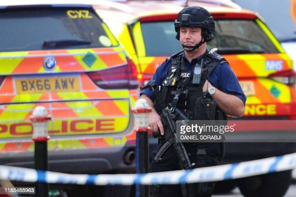 An armed police officer covers a cordon near London Bridge in London on November 29 2019 after reports of shots being fired on London Bridge A man...