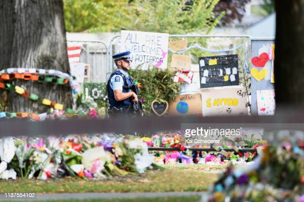 An armed police officer is seen in front of Al Noor mosque during Friday prayers on March 22 2019 in Christchurch New Zealand 50 people were killed...