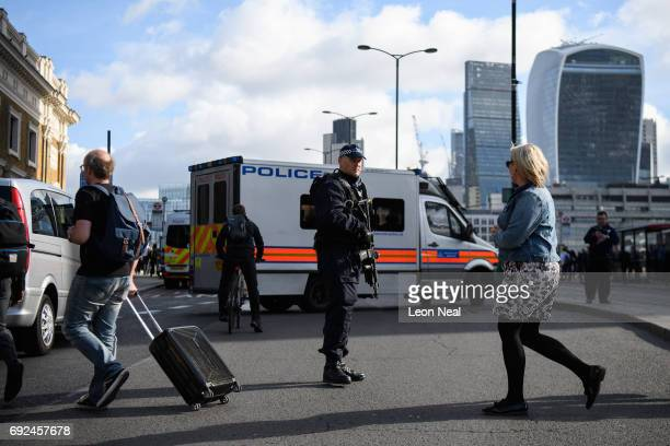 An armed police officer is seen on London Bridge after it was reopened following the June 3rd terror attack on June 5 2017 in London England Seven...