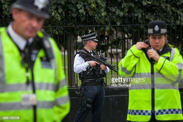 An armed police officer on duty at The Houses of Parliament on September 26 2014 in London England MPs will vote later today on whether the UK should...