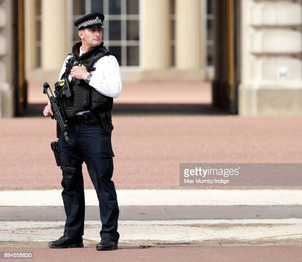 An armed police officer on duty outside Buckingham Palace during The Colonel's Review on June 10 2017 in London England The Colonel's Review is the...