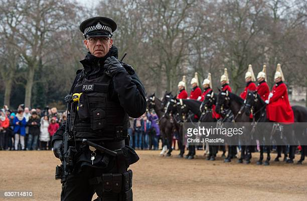 An armed police officer patrols Horse Guard's Parade during the Changing of the Guard ceremony as security is steppedup across London ahead of New...