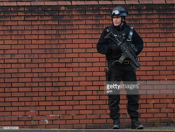 An armed police officer patrols outside Preston Crown Court in Preston northwest England on February 7 ahead of the start of the trial in which Dale...