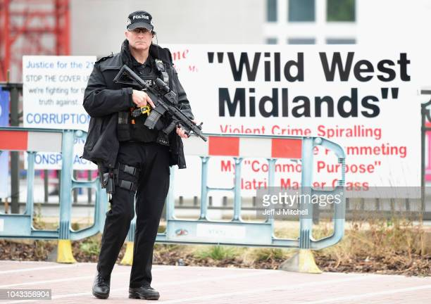An armed police officer patrols the area during the annual Conservative Party Conference on September 30, 2018 in Birmingham, England. The...