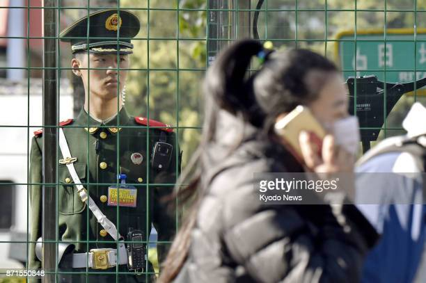 An armed police officer stands guard on Nov 8 near a hotel in Beijing where US President Donald Trump will stay during his visit to China as part of...