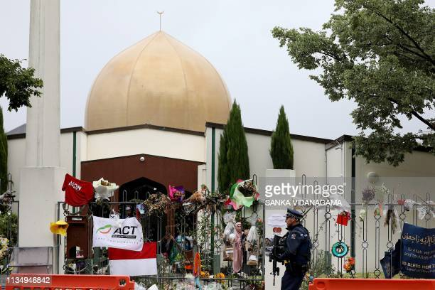 An armed police officer stands guard outside the Al Noor mosque, one of the mosques where some 50 people were killed by a self-avowed white...
