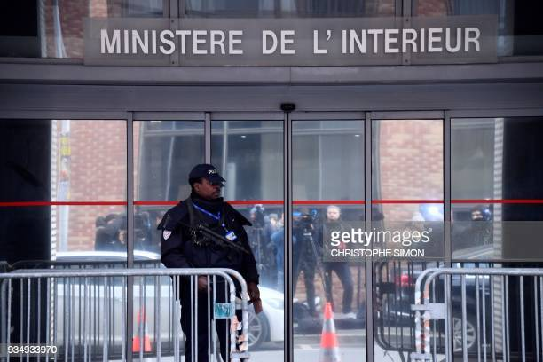 An armed police officer stands guard outside the headquarters of the Central office for the fight against corruption and financial and fiscal crime...