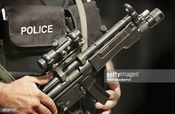 An armed police officer stands in Downing Street on July 26 2005 in London Prime Minister Tony Blair will meet with opposition leaders to discuss...
