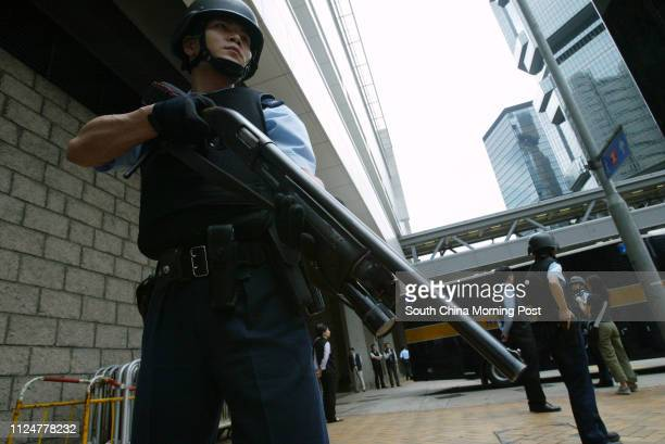 An armed policeman guards outside High Court while Kwai Pinghung the most wanted man in Hong Kong on trial Kwai Pinghung 45yearold is facing a 24...