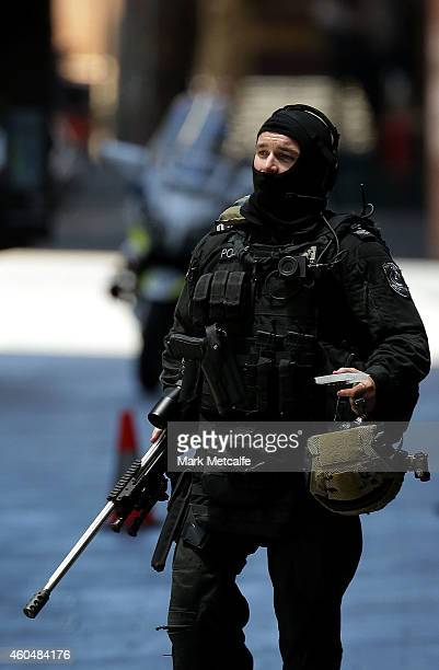An armed policeman is seen in Phillip St on December 15 2014 in Sydney Australia Police attend a hostage situation at Lindt Cafe in Martin Place