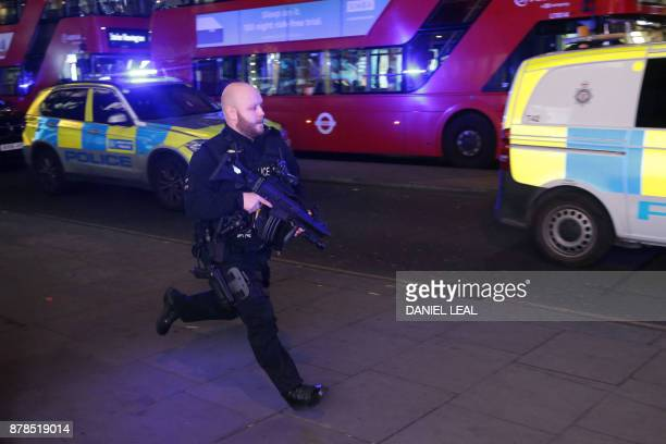 An armed policeman runs down Oxford Street in central London on November 24 as police responded to an incident British police said they were...