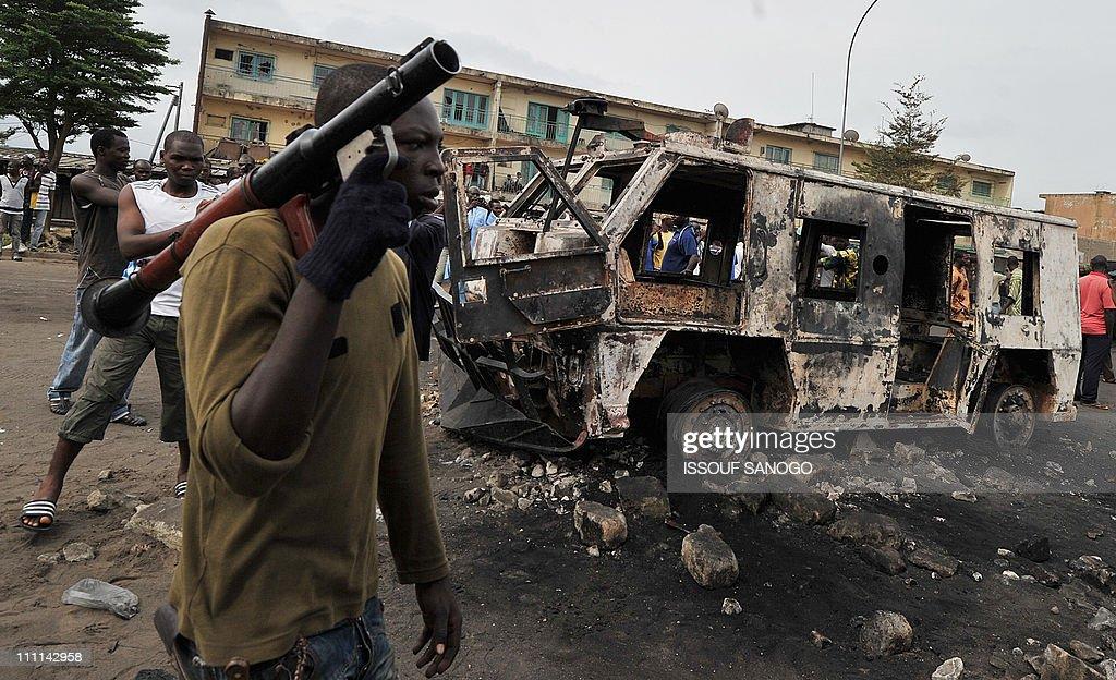 An armed pro- Alassane Ouattara fighter : News Photo