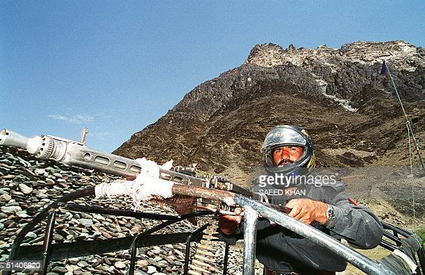An armed security official stands alert near the hill under which the country's five nuclear tests were carried out situated in southwestern...