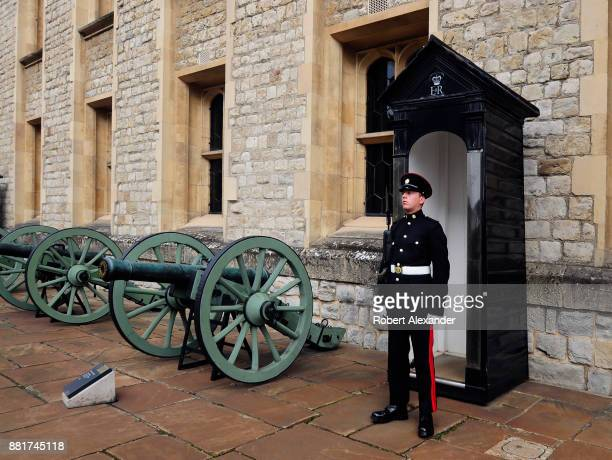 An armed sentry stands at his post in the Tower of London complex in London England The sentry is a part of a military guard stationed at the Tower...