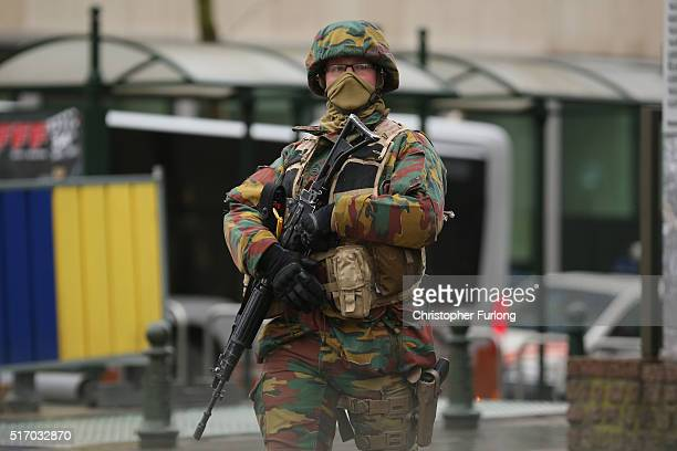 An armed soldier patrols near the EU Commission Headquarters in after yesterday's terrorist attacks on March 23 2016 in Brussels Belgium Belgium is...