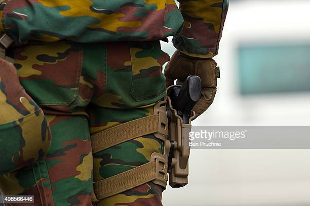 An armed soldier stands guard on Rue Du Midi on November 24 2015 in Brussels Belgium At a press conference last night the Belgian Prime Minister...
