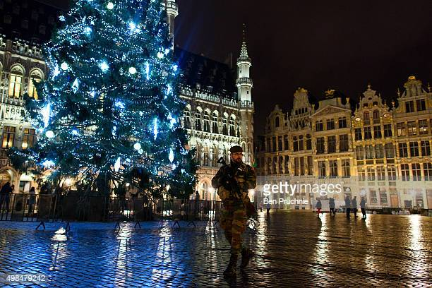 An armed soldier stands guard over the Grote Markt on November 23 2015 in Brussels Belgium Security has been tightened in the nation's capital after...