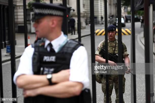 An armed soldier stands inside Downing Street on May 24 2017 in London England 984 military personnel are being deployed around the country as the UK...
