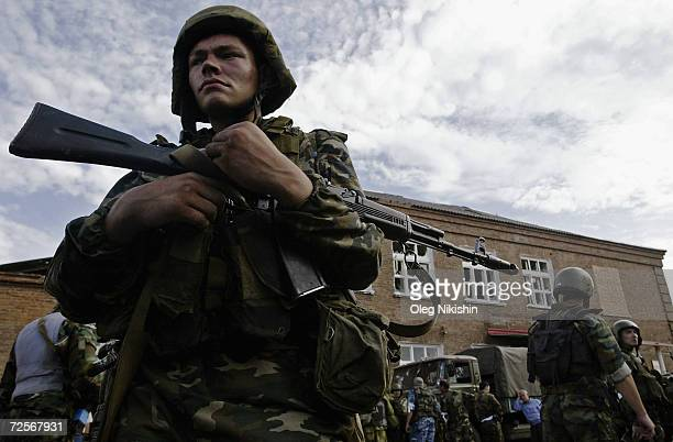 An armed soldier surveys the area after special forces stormed a school seized by Chechen separatists on September 3 2004 in the town of Beslan...