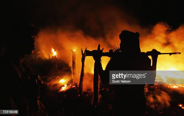 An armed Sudanese rebel from the Justice and Equality Movement arrives at the abandoned village of Chero Kasi less than an hour after Janjaweed...