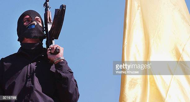An armed supporter of controversial Iraqi Shia cleric Moqtada alSadr takes part in a rally on April 5 2004 at the cleric's Sadr City headquarters in...