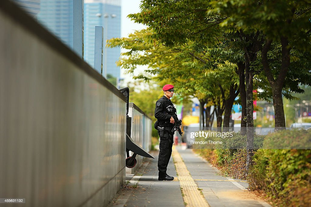 An armed SWAT member stands outside the International Broadcast Centre prior to the 17th Asian Games on September 18, 2014 in Incheon, South Korea.
