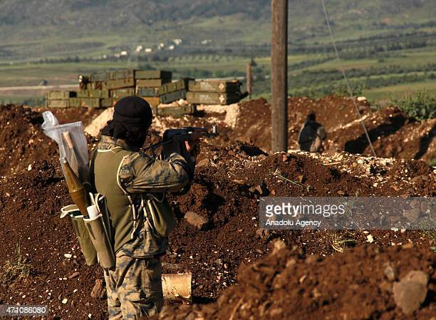 An armed Syrian opponent is seen before seizing the control of the Jisr alShughur town in Idlib Syria on April 25 2015 Syrian opponents carried out...