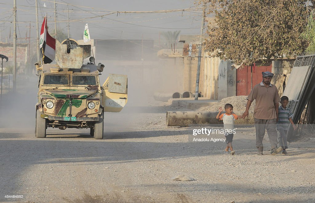 An armed wehicle passes on a street in Amirli after Iraqi forces have entered the northern town of Amirli which had been under the siege of Islamic State militants for over two months in Saladin ,Iraq on September 1, 2014. Supported by Kurdish forces and Shiite militias, the Iraqi army launched an offensive shortly after the U.S. carried out airstrikes against Islamic State (IS) positions near the town, and dropped aid for the nearly 20,000 Shiite Turkmen trapped in Amirli. The government forces and Kurdish peshmerga forces have been fighting against the militant group to block their advance.