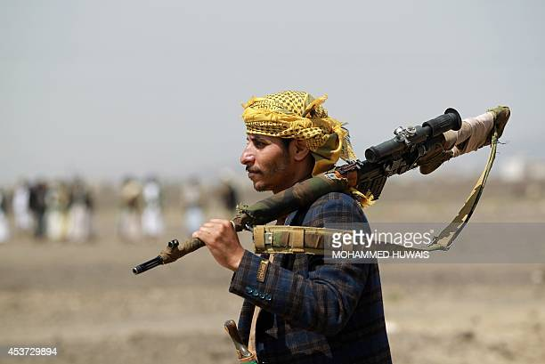 An armed Yemeni man loyal to the Shiite Huthi movement holds his gun during a tribal gathering against alQaeda militants in the Bani alHarith area...