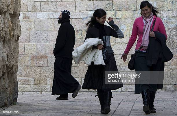 An Armenian priest walks near Jewish gild in Jerusalem's Old City Armenian Quarter on January 24 2011 a day after leaked documents were published by...