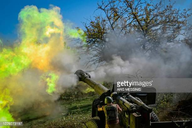 An Armenian soldier fires artillery on the front line on October 25 during the ongoing fighting between Armenian and Azerbaijani forces over the...