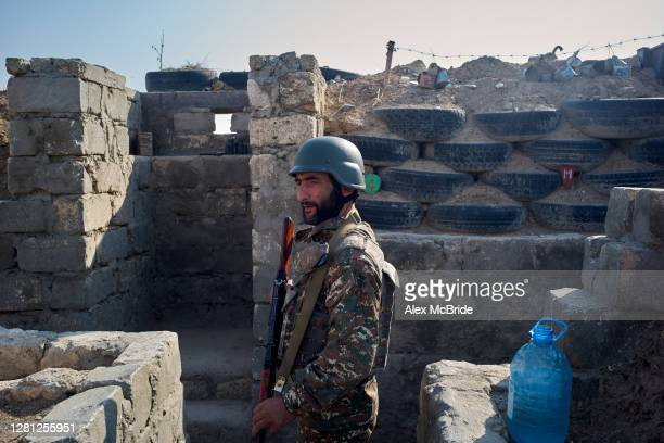 An Armenian soldier stands in the trenches on a frontline position on October 20, 2020 near Aghdam, Nagorno-Karabakh. As the war over control of...