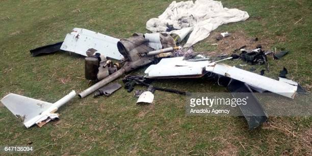 "An Armenian unmanned aerial vehicle , also known as ""drone"" is seen on the ground after Azerbaijani troops shot down, at Agdam region in Baku,..."