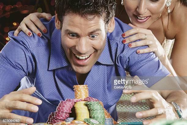 An armful of gambling chips