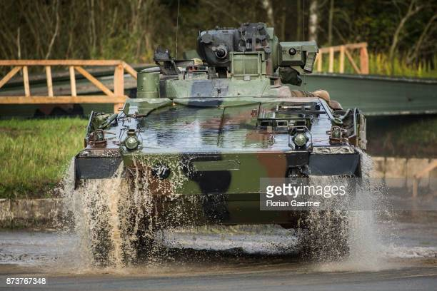 An armored infantry fighting vehicle 'Marder' is driving through a moat. Shot during an exercise of the land forces on October 13, 2017 in Munster,...