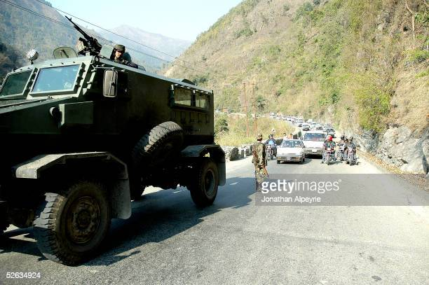 An armored Nepali vehicle stops on the road leading to the Tribhuvan highway while the road ahead is cleared February 26 2005 in the eastern Terai...