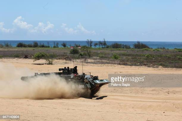 An armored personnel carrier in action Indian armed forces air force army and navy gave a joint live demonstration of the capabilities of their...