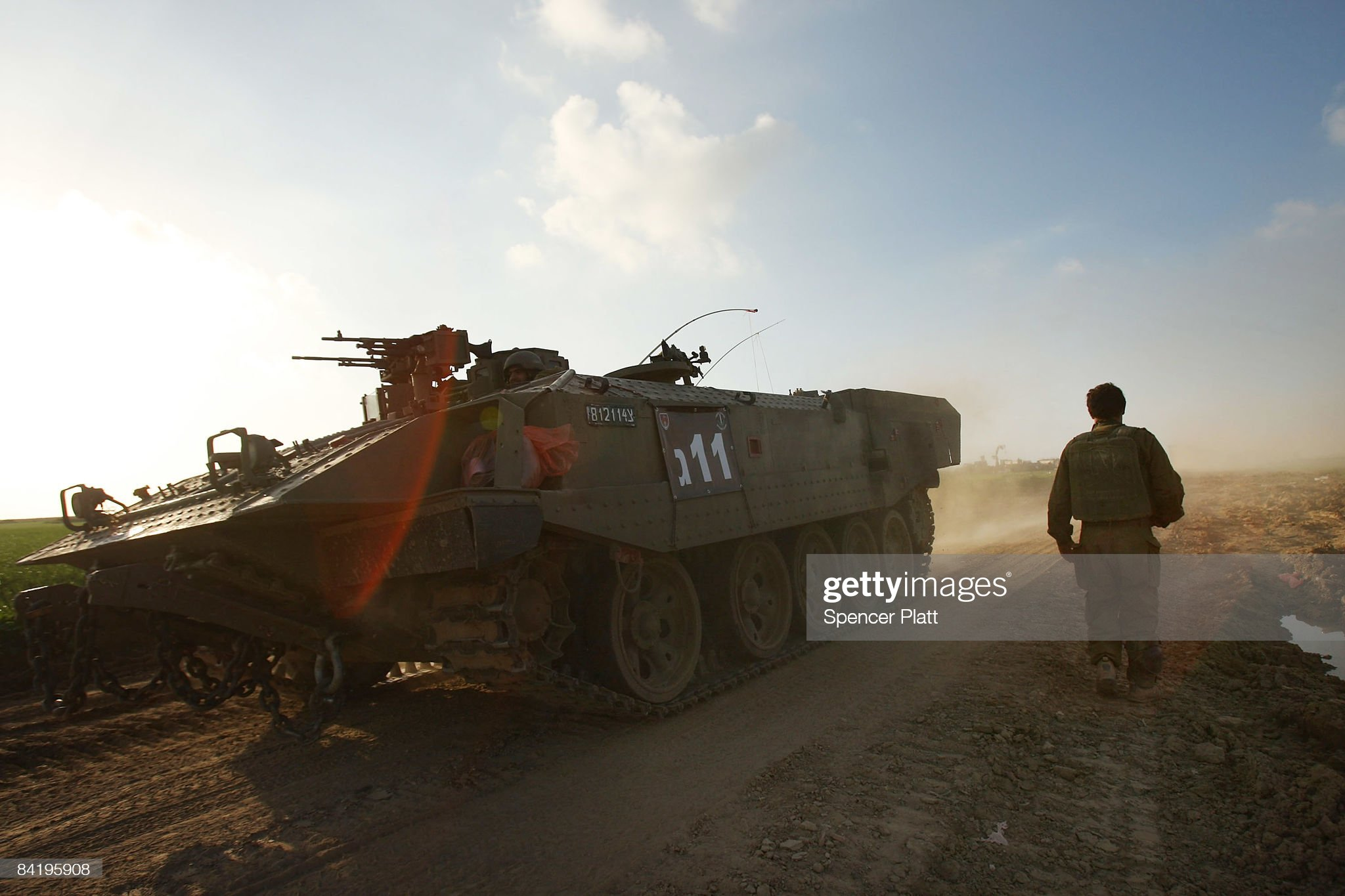 https://media.gettyimages.com/photos/an-armored-personnel-carrier-passes-an-israeli-soldier-during-the-of-picture-id84195908?s=2048x2048