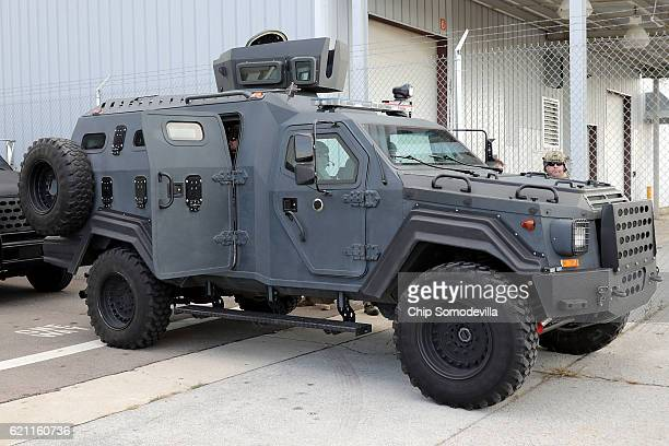 An armored police vehicle is parked near a campaign rally for Republican presidential nominee Donald Trump at the Airborne Maintenance Engineering...