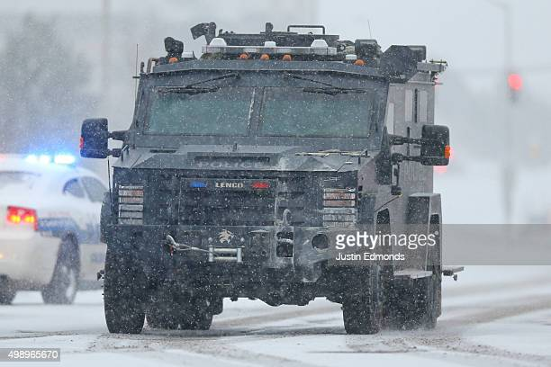 An armored police vehicle transports hostages to safety during an active shooter situation outside a Planned Parenthood facility where an active...